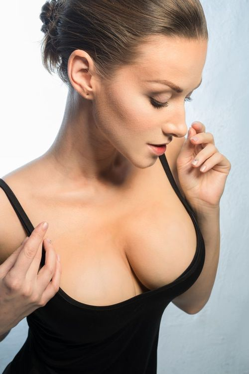 Woman wearing a black bra.