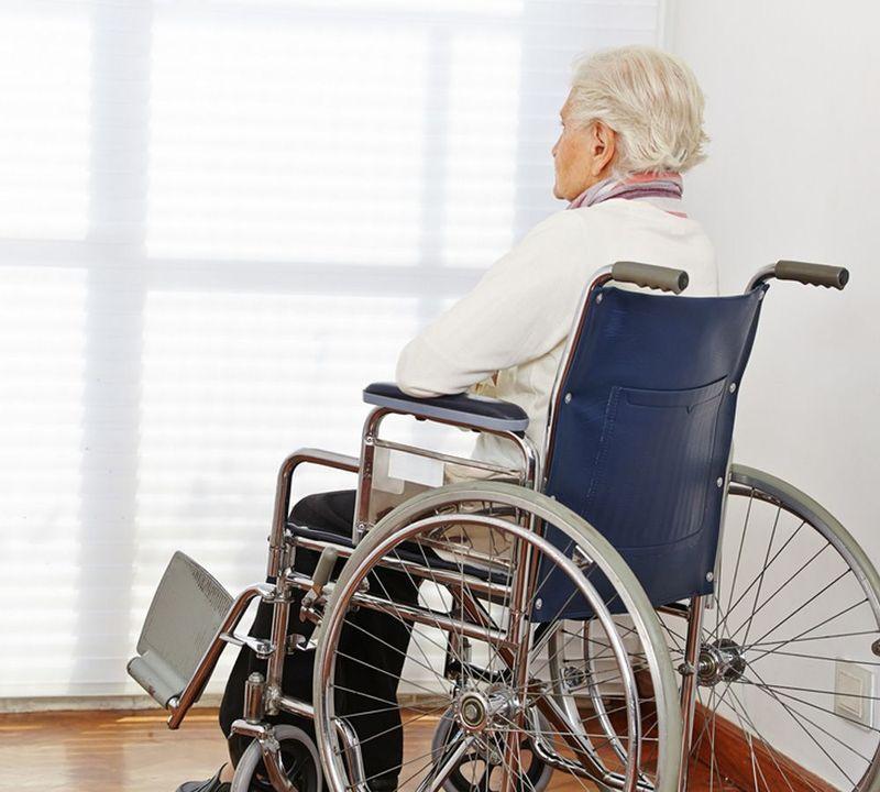 elderly woman in a blue chair