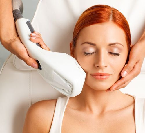 Woman with red hair receiving spa skin treatment