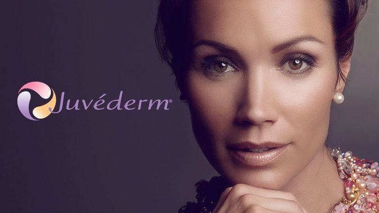 Smiling woman and Juvederm logo