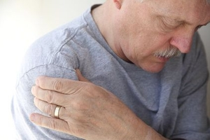An older man feeling shoulder pain