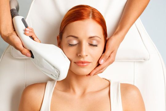 Young woman receives IPL Photofacial skin treatment