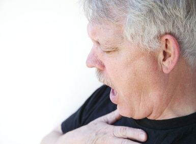 man having trouble breathing