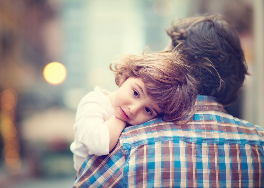Man holding young girl over his shoulder
