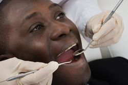 Patient receiving a dental exam.