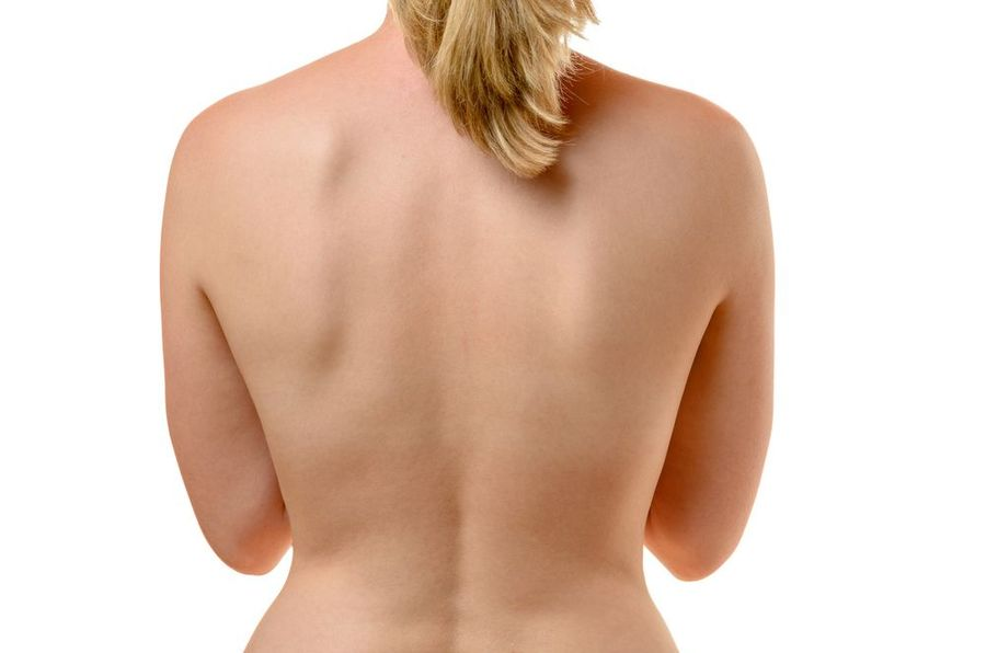 A naked woman with her back to the camera.
