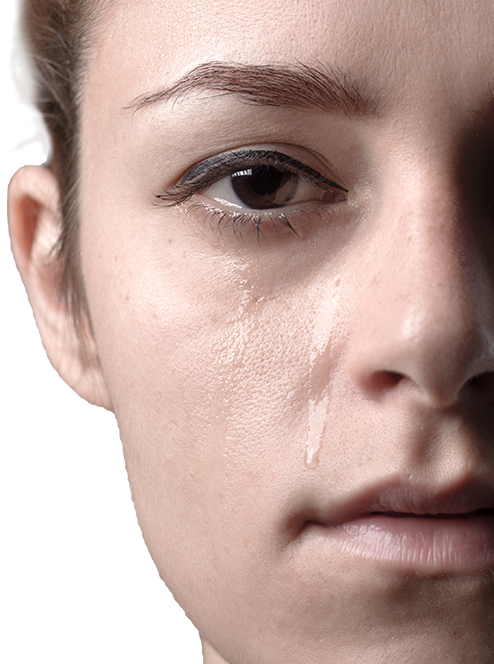 Woman's face with tears running down cheek