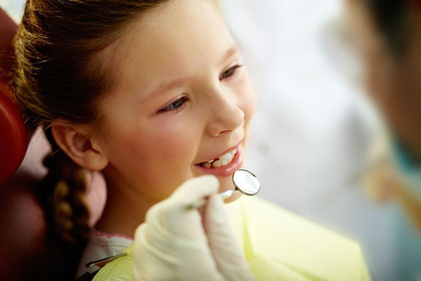 Young girl undergoing pediatric dentistry exam