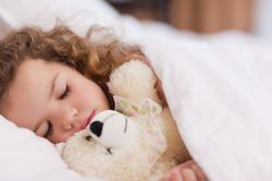 child with stuffed bear