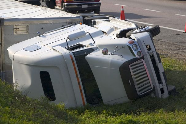 Underside view of an overturned big rig truck