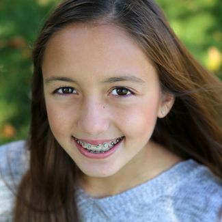 image of smiling child with braces