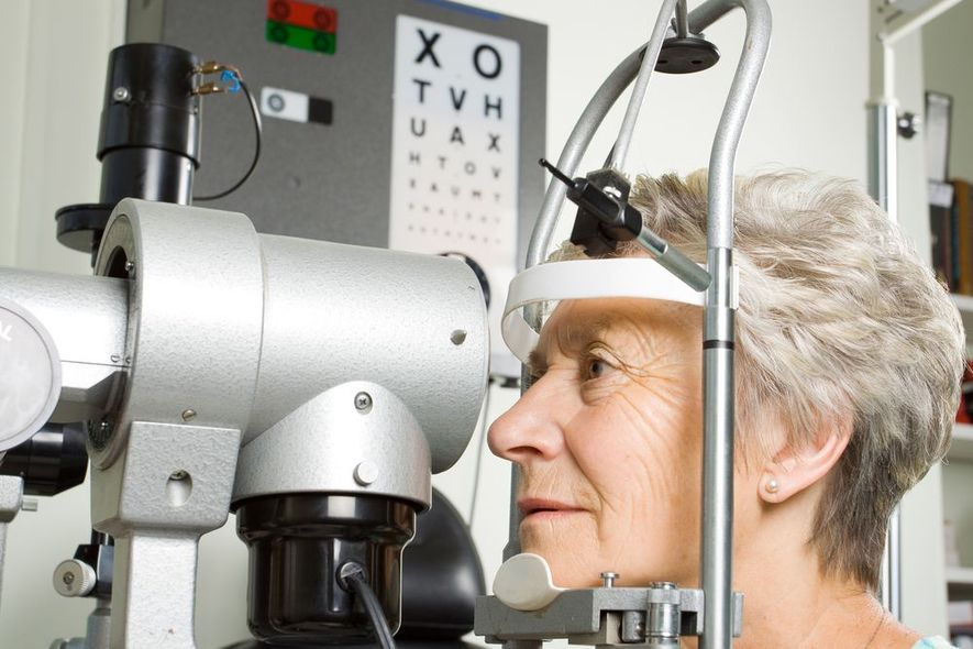 Female Patient Receives Eye Exam