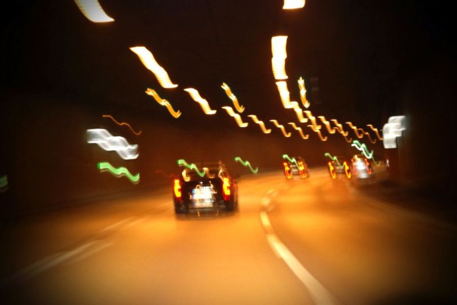 Blurred photo of cars driving in a tunnel
