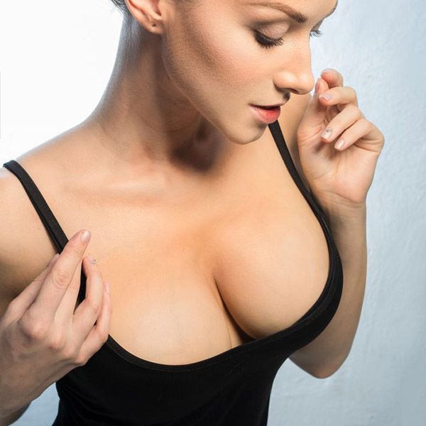 Woman's cleavage in black shirt