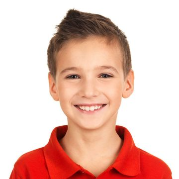Young, smiling boy wearing a red shirt.