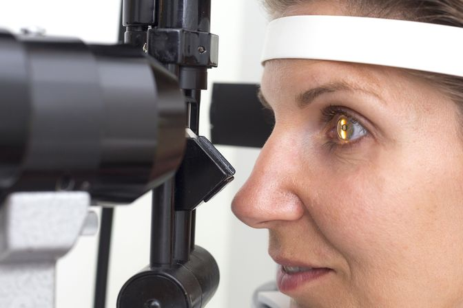 A patient having her eyes examined