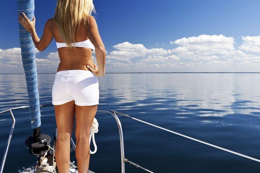 Woman in a white bikini on a boat