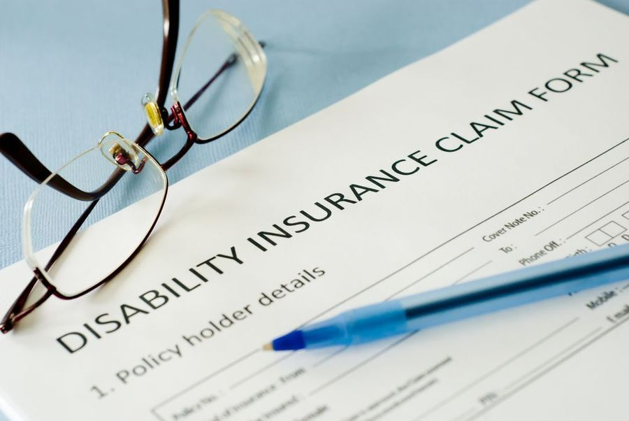 Disability insurance claim form paperwork.