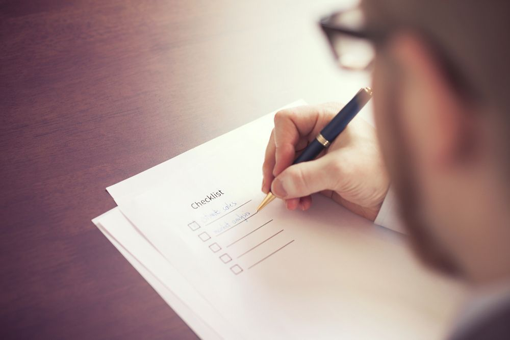 Photo of a person writing a checklist