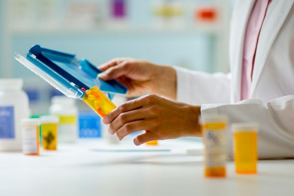 Image of pharmacist filling drug prescription
