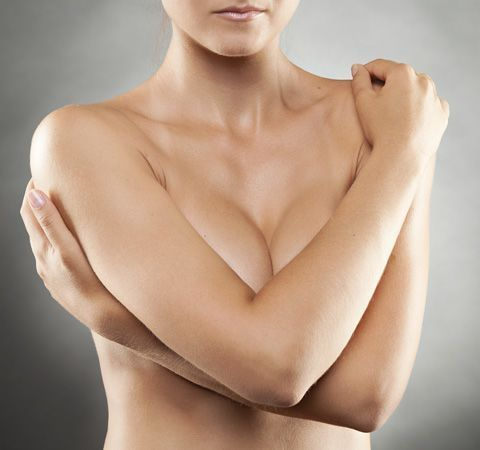 Image of woman holding her chest