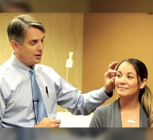 Dr. John F. Zavell in a consultation with a patient.