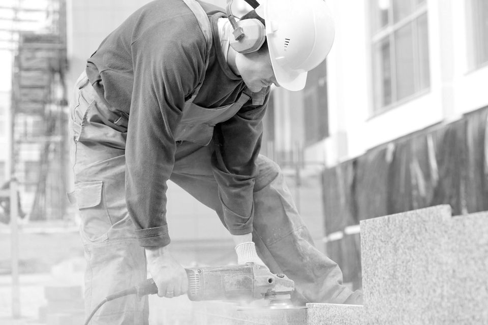 A construction worker working without proper eye protection