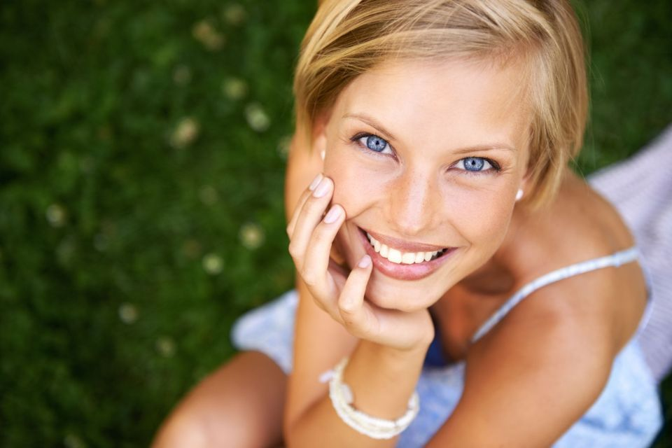 Smiling blond posing on the grass