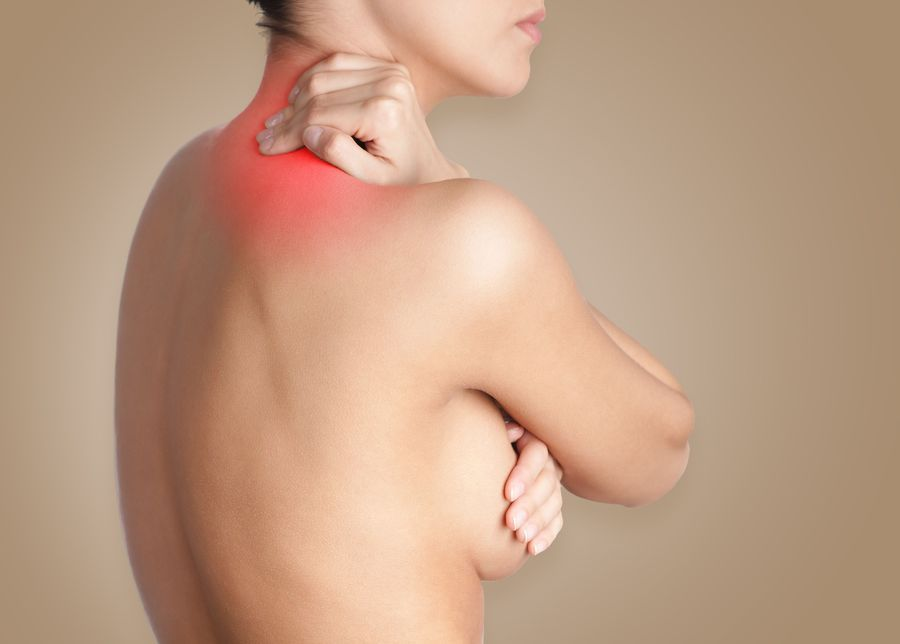 Woman holding neck highlighted i red