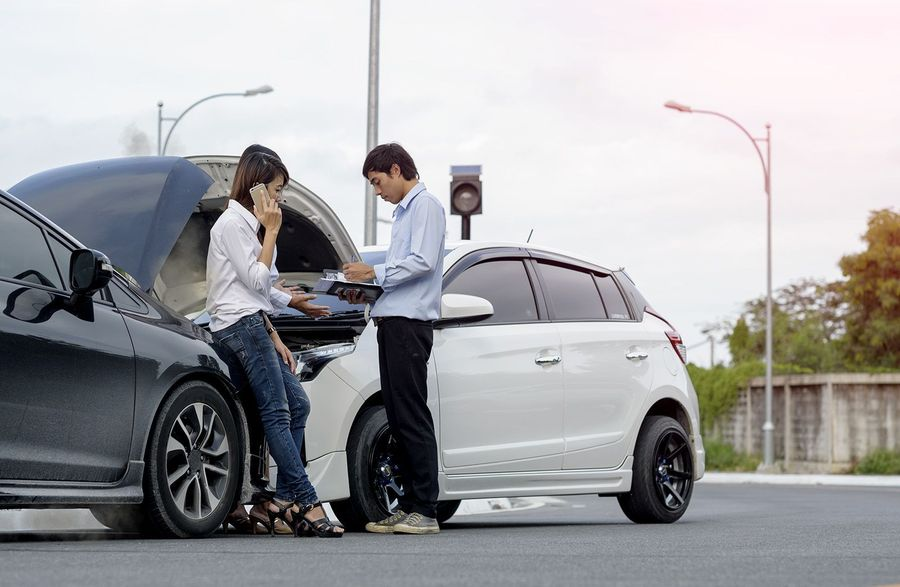 A man and woman exchanging information after an accident