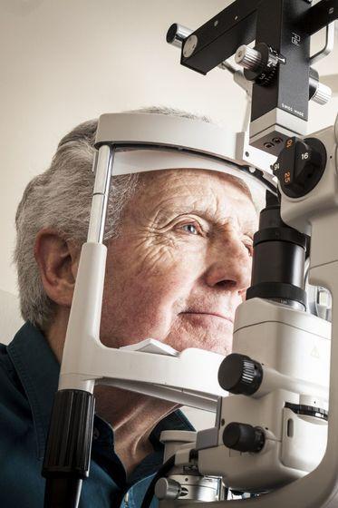Older man receiving an eye examination.