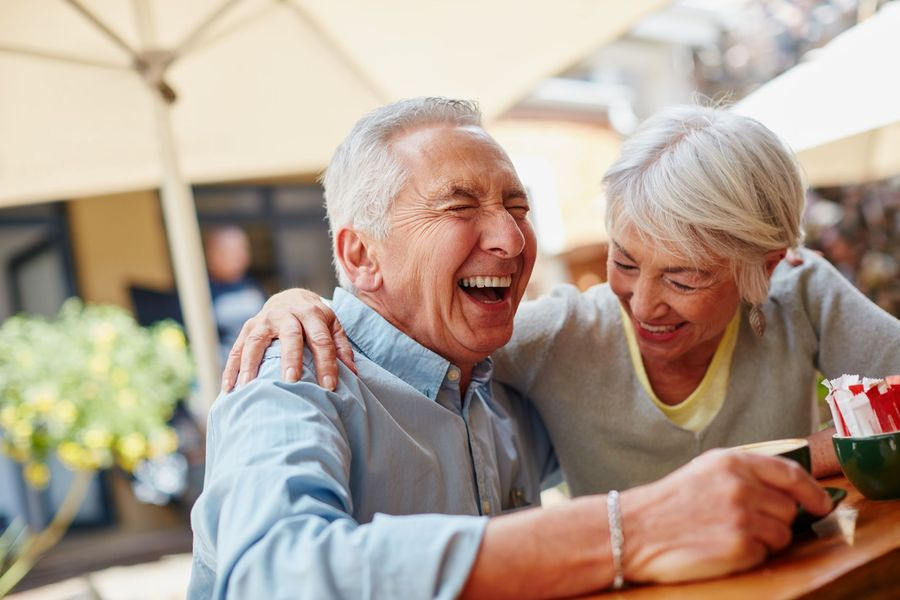 Photo of an older laughing couple
