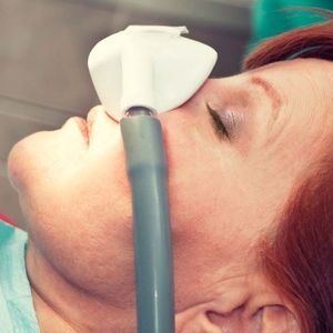 woman with sedation mask over nose