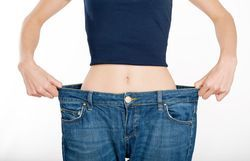 woman in large pants holding out the waistline