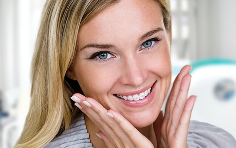 Smiling woman with braces framing mouth