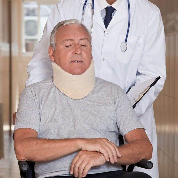 man in wheelchair wearing neck brace