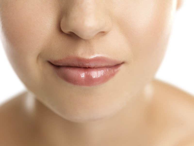 Closeup on woman's lips.