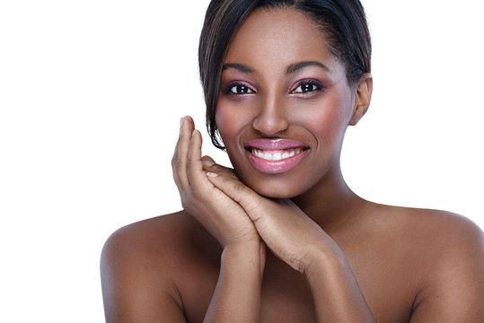 Smiling woman with smooth skin