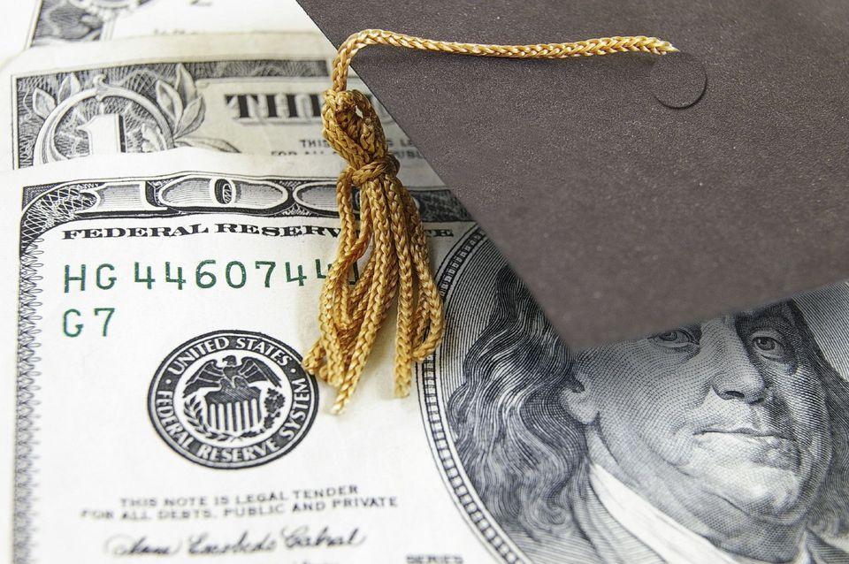 A graduation cap and a $100 bill