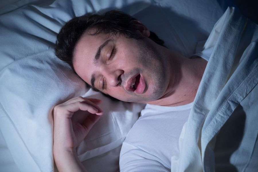Man sleeping with mouth wide open