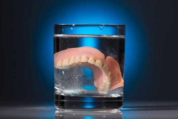 Denture in glass of water