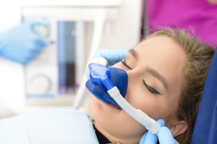 Woman sleeping through dental procedure