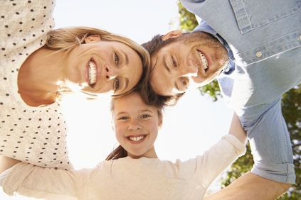 Image of a smiling family of three