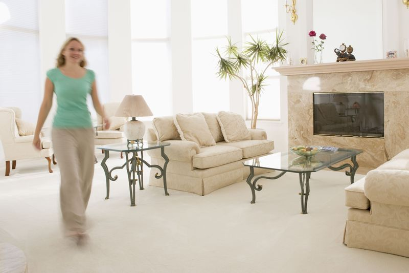 Blurred image of woman walking in living room