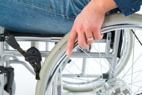 Close up photo of someone sitting in a wheelchair