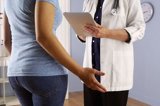 Female patient speaking with doctor