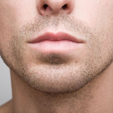 Close-up photo of a man's chin and mouth