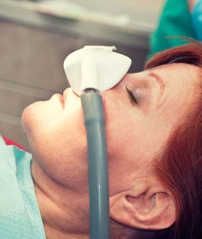 A patient undergoing sedation dentistry during a procedure.