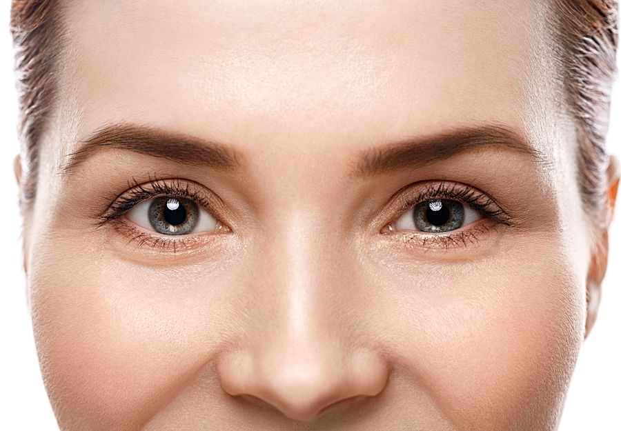 A close up of a woman's mid facial area.