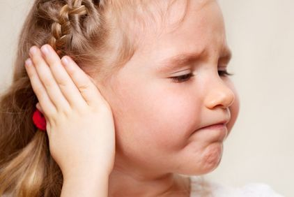Young girl with hand to her ear